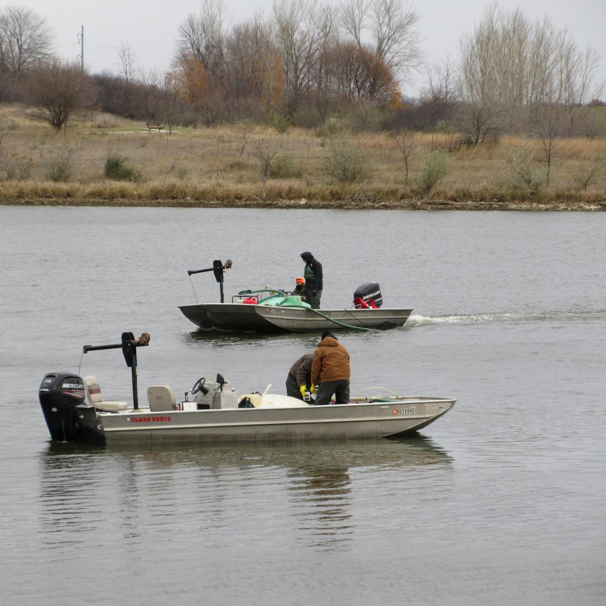 The Nebraska Game and Parks crew applies a chemical called rotenone to Pawnee Reservoir to eradicate white perch and gizzard shad. NEBRASKA GAME AND PARKS
