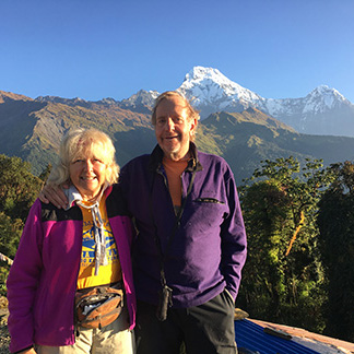 Sylvia and Roger Wiegand in Tadapani, view of Annapurna South, in Nepal
