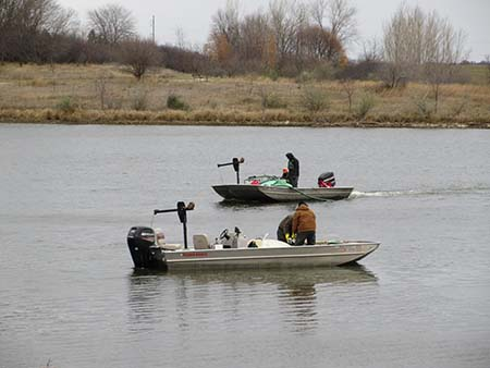 The Nebraska Game and Parks crew applies a chemical called rotenone to Pawnee reservoir to eradicate white perch and gizzard shad.