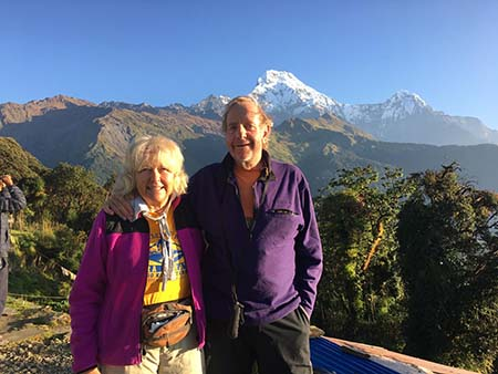 Sylvia and Roger Wiegand in Tadapani, view of Annapurna South (7,273 m) and Hiuchuli (6,441 m).