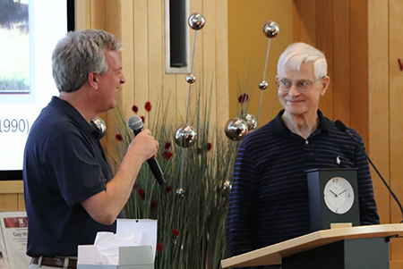 Allan Peterson accepts a gift from the Department and Chair Tom Marley (left) at the April 2018 recognition reception.