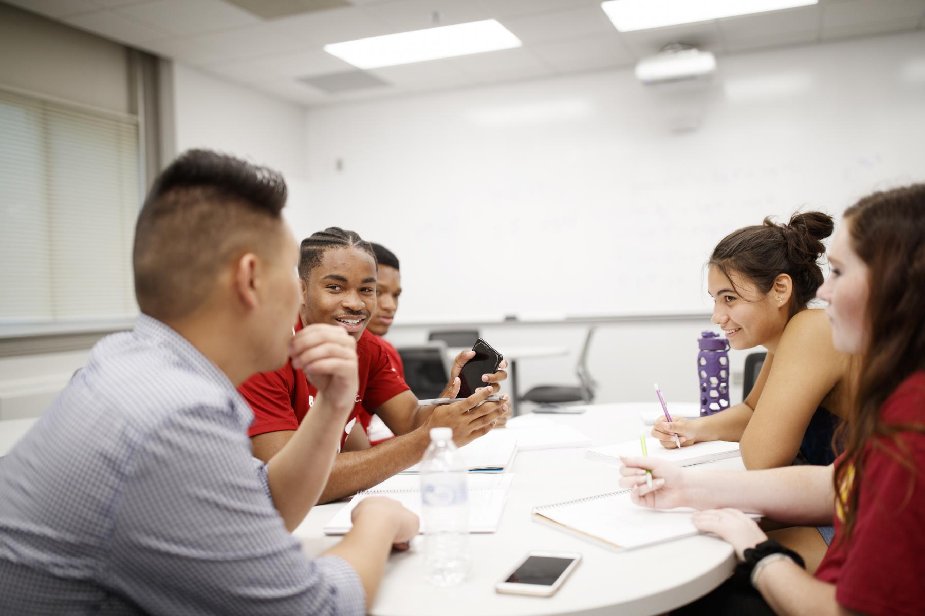 Mathematics graduate student Justin Nguyen assists students in Math 106: Calculus I in Fall 2019 in the newly renovated Louise Pound Hall.